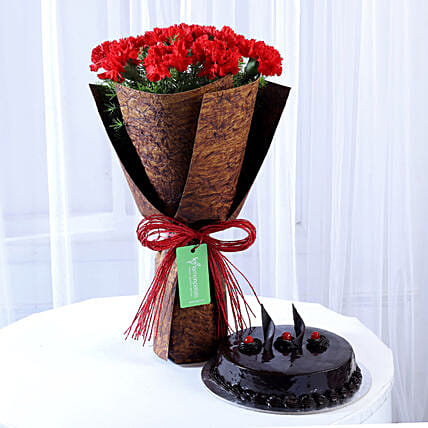 12 Beautiful Red Carnations & Truffle Cake: Send Carnations