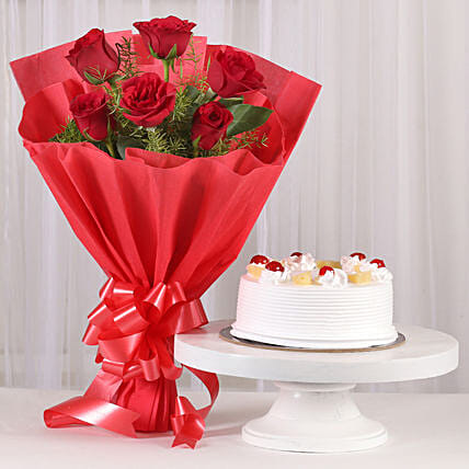 Red Roses & Pineapple Cake Combo: Flower Bouquet with Cake