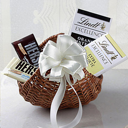 Lindt Chocolates Cane Basket Hamper: Christmas Gift Hampers