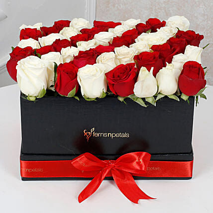 Peaceful Whites N Reds Arrangement: Premium Gifts