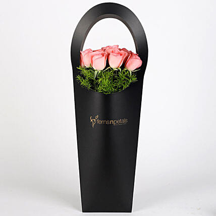 Pink Roses in Stylish Black Sleeve: Fresh Flower Arrangement