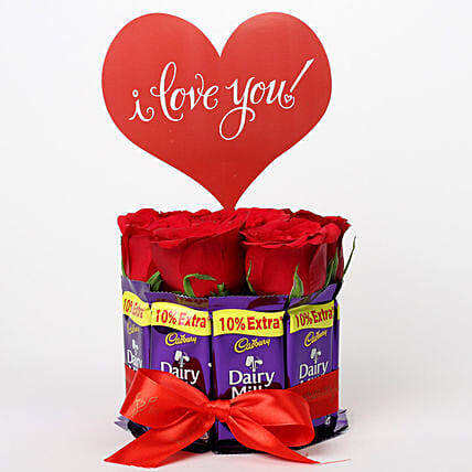 Red Roses in Glass Vase & Dairy Milk Arrangement: Gift Combos For Anniversary