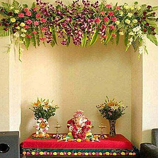 Scintillating Floral Ganpati Decoration: Lilies