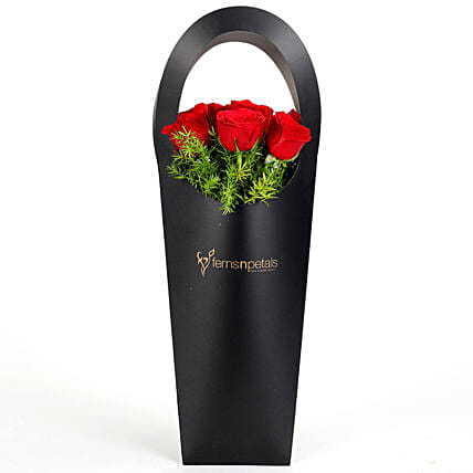 Red Roses in Stylish Black Sleeve: Anniversary Flowers