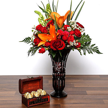 Asiatic Lilies and Roses In Vase With Chocolates: Same Day Rose Delivery in UAE