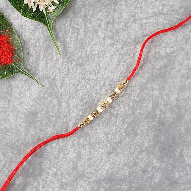 Elegant Premium Designer Thread: Send Pearl Rakhi to UK