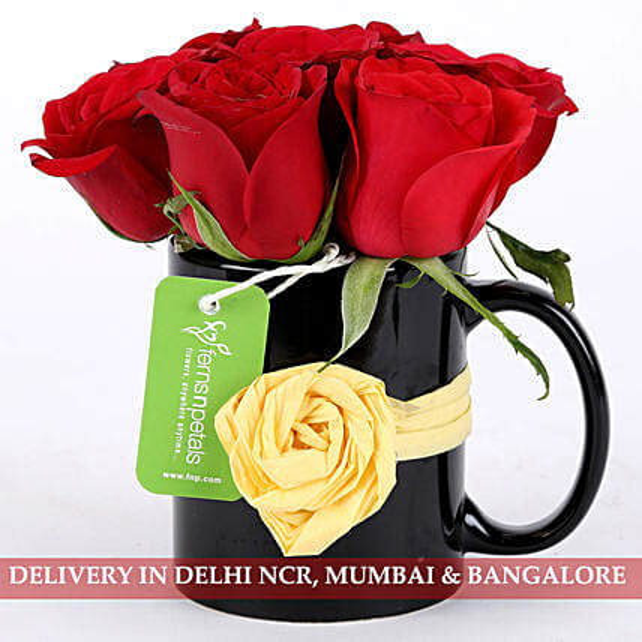 roses arrangement in attractive mug