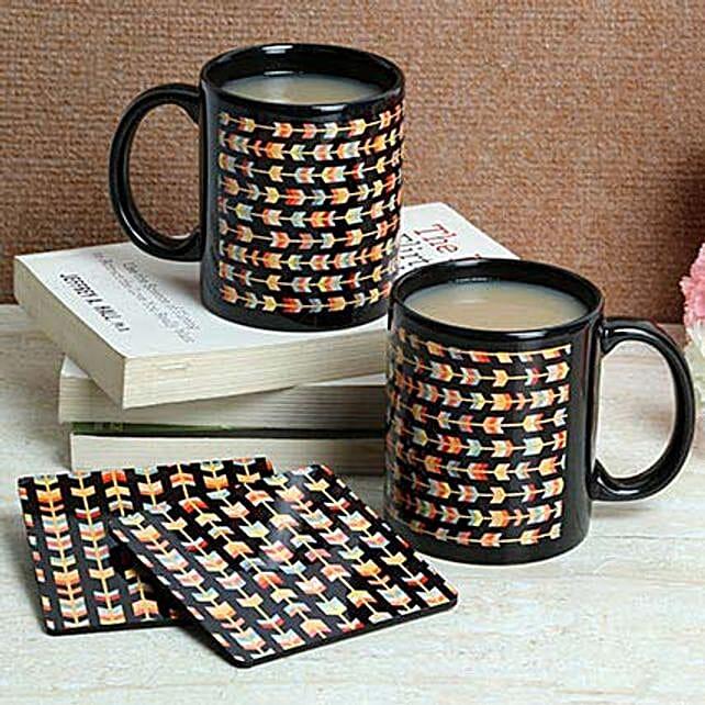 Hamper of two printed ceramic black mugs and tea coasters