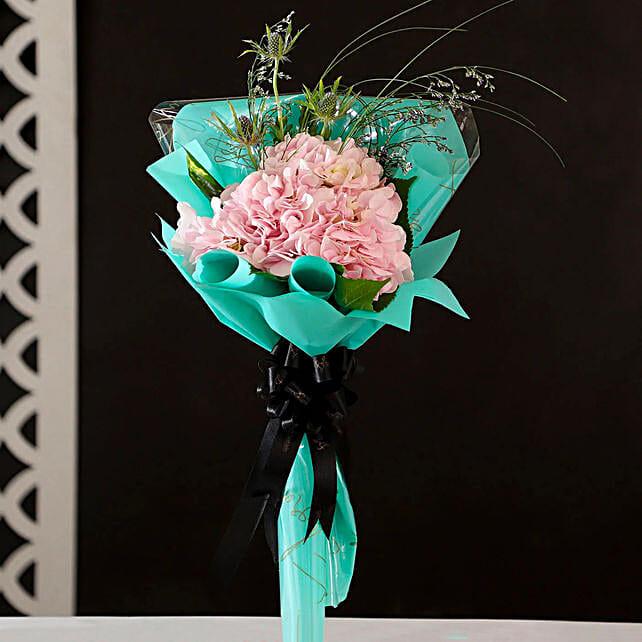 online pink hydrangea in blue wrap paper