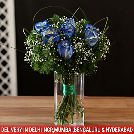 exotic blue shade roses in glass vase arrangement