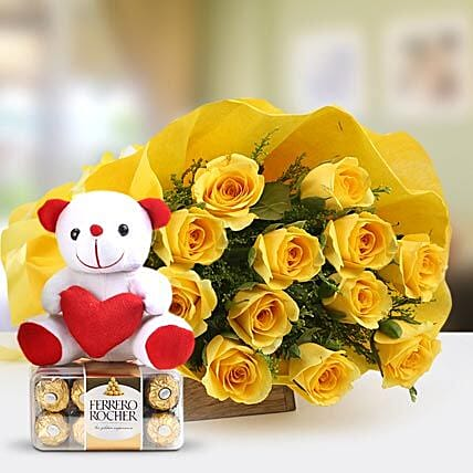 Care Express - Bunch of 12 Yellow Long Stem Roses packing with 6Inch Soft toy and 200gm Ferrero Rocher Chocolate box.