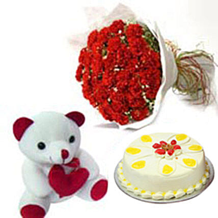 Carnation of Paradise - Bunch of 50 Red carnations in paper wrapping with 500gm Butter Scotch Cake and a .