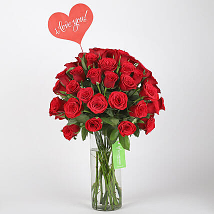 red roses arrangement in glass vase