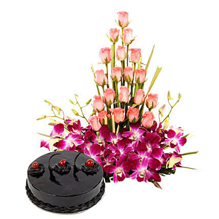 Colour N Cake - Basket arrangement of 20 pink roses with 6 purple orchids and 1 kg chocolate truffle cake.