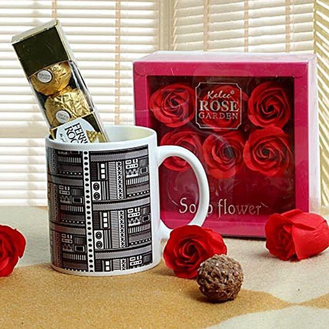 Hamper of printed ceramic white mug, rose paper soap square box and ferrero rocher chocolates