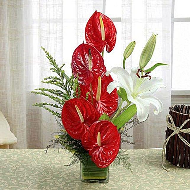 Square glass vase arrangement of flowers