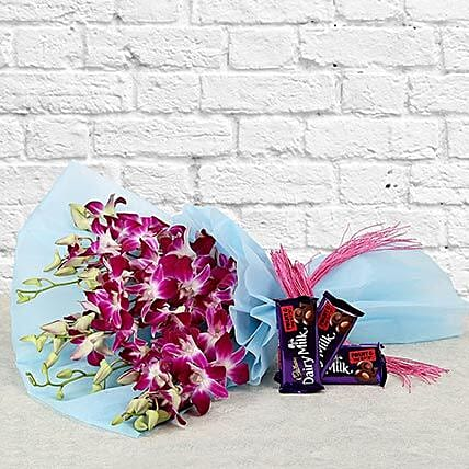 Purple orchids bouquet with chocolates