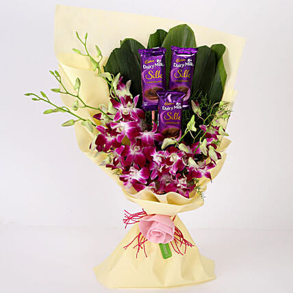 Online Dairy Milk & Orchids Bouquet