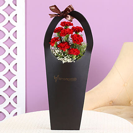 carnation flower in black sleeve bag