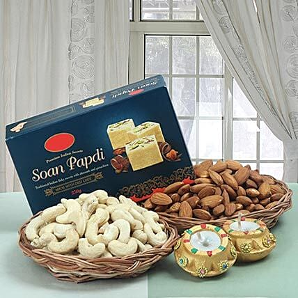 Combo of sweets, dry fruits and diyas