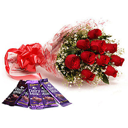 Bouquet of red roses and chocolates