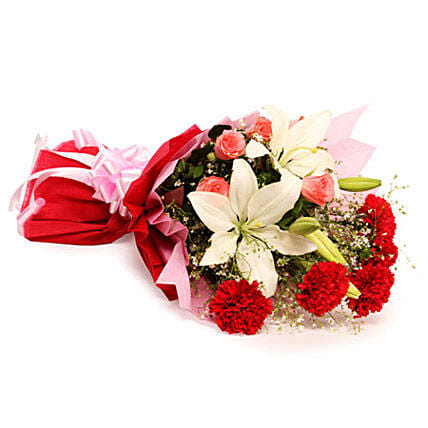 Bouquet of 2 asiatic lilies, 5 red carnations, 5 pink roses, and seasonal filler