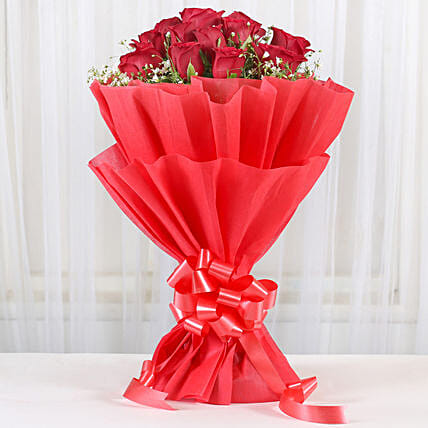 Love Around - Bunch of 12 Long Stem Red Roses inred paper packing.