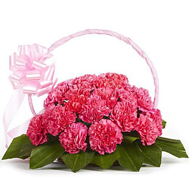 Memorable Moments - Basket arrangement of 20 pink carnations.