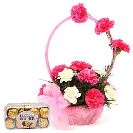 Pink N White Basket Of Flavours - 10 carnations in a handle basket and Ferrero Rocher 200gms.