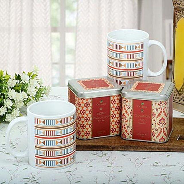 A hamper of ceramic white mugs, octavius indian masala black tea, octavius cinnamon anise green tea