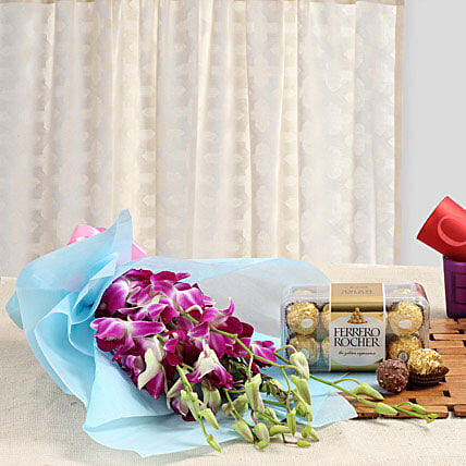 Radiance Of Romance - Bunch of 6 purple Orchids and 200 grams Ferrero Rocher chocolates.