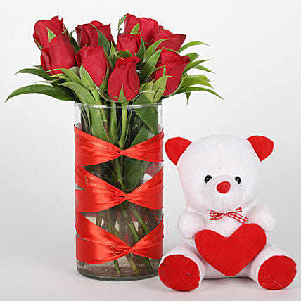 Elegant roses in vase with teddy bear for her