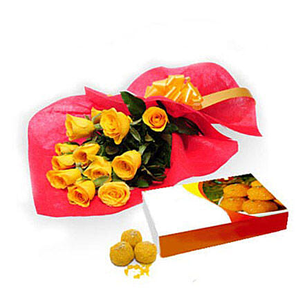 Roses with Motichur Laddu - Bunch of 12 Yellow Roses in Red Color paper packing with Yellow ribbon & Box of 1kg Motichur Laddu from Good Confectionery.