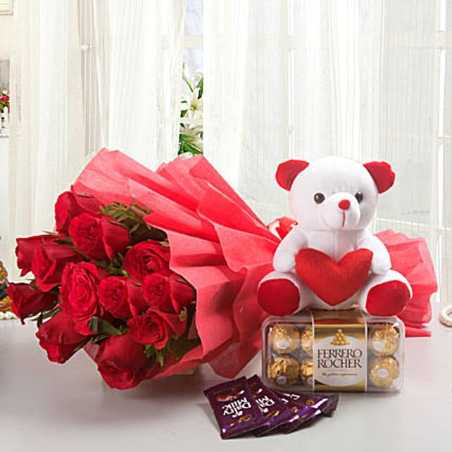 Rosy Combo - Bunch of 12 Long Stem Fresh Red Roses with 5 Cadbury Dairy Milk chocolates 14gm each, 200gm Ferrero rocher chocolate box & Soft toy.