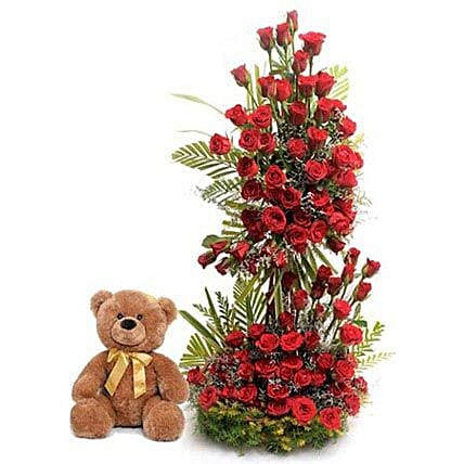 Sweet Surprise - 3-4 feet height tall arrangement with 100 Red Roses and 1 feet height huggle  from Archies.