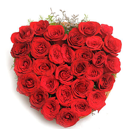 Blooming Love - Heart shape arrangement of 30 red roses in a basket.