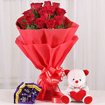 Cuddly Affair - bunch of 12 red roses with 6 inch teddy and 5 Cadbury Dairymilk .
