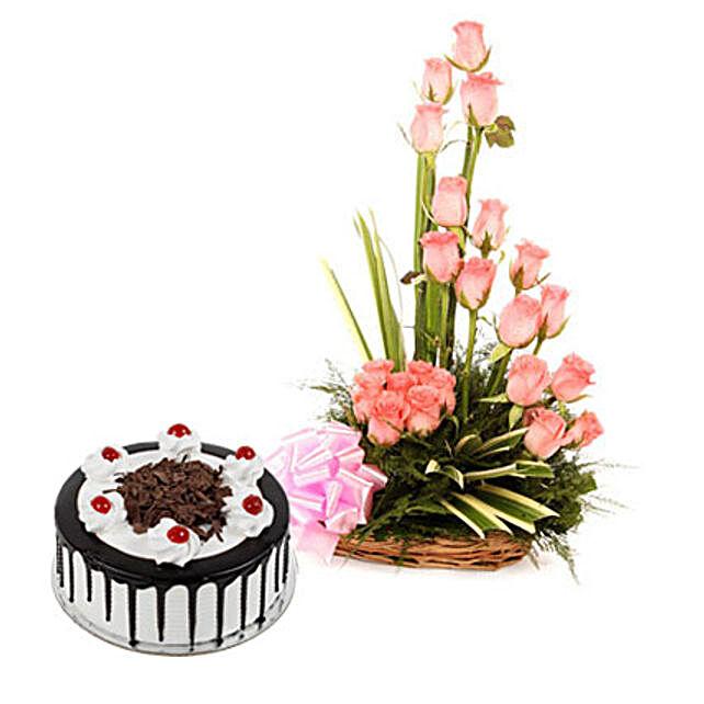 Pink Roses N Chocolate Treat - Basket arrangement of 20 Pink roses and half kg balckforest cake.