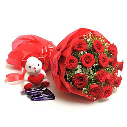 Sweet Romance - Bunch of 15 Red Roses in paper packing with 5 cadbury chocolates and cute soft toy.